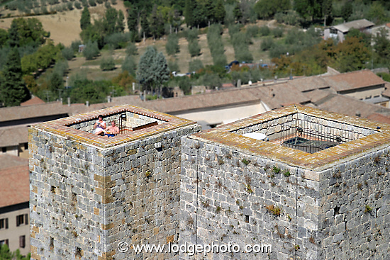 The top of your private medieval tower provides the perfect platform for sun-bathing. San Gimignano, Tuscany, Italy.